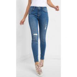 Jeansy skinny z kryształkami. Żółte jeansy damskie skinny marki Orsay, s, z bawełny, z golfem. Za 139,99 zł.