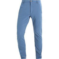 DOCKERS SMART 360 FLEX ALPHA SKINNY Spodnie materiałowe sunset blue. Niebieskie rurki męskie DOCKERS, z bawełny. Za 399,00 zł.