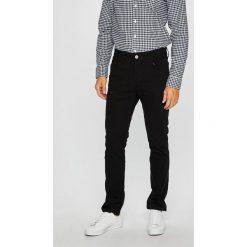 Jack & Jones - Spodnie. Czarne rurki męskie marki Jack & Jones, l, z bawełny, z klasycznym kołnierzykiem, z długim rękawem. W wyprzedaży za 119,90 zł.