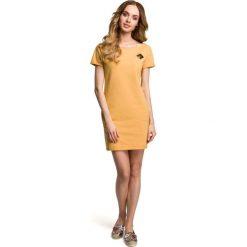 Żółta Dopasowana Mini Sukienka z Ozdobną Naszywką. Białe sukienki dzianinowe marki bonprix, na plażę, w koronkowe wzory. Za 88,90 zł.