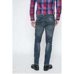Guess Jeans - Jeansy Adam. Niebieskie jeansy męskie skinny Guess Jeans, z aplikacjami, z bawełny. Za 399,90 zł.