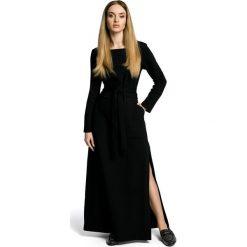 VANDA Sukienka maksi z rozcięciem - czarna. Czarne sukienki dresowe Moe, z długim rękawem. Za 179,90 zł.