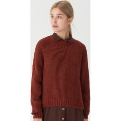Sweter oversize - Bordowy. Czarne swetry oversize damskie marki KIPSTA, z poliesteru, do piłki nożnej. Za 99,99 zł.