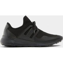 Buty męskie: Buty sportowe z elastycznego materiału z ozdobą z boku
