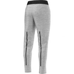 Adidas Spodnie Tappered Pant szare r. XS (AJ6343). Czarne spodnie sportowe damskie marki Adidas, xs. Za 186,49 zł.