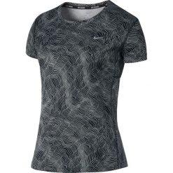 Koszulka do biegania damska NIKE DRY MILER TOP SHORT SLEEVE PRINT / 799560-010. Niebieskie topy sportowe damskie marki 4f, s. Za 95,00 zł.