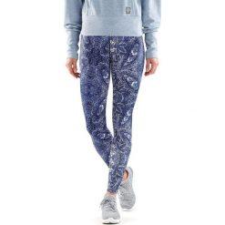 Spodnie dresowe damskie: Skins  Spodnie sportowe damskie SPDF106 Allover niebieskie r. S