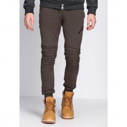 Khaki Spodnie Dresowe Tie the Best. Czarne spodnie dresowe męskie marki Born2be, m, z nadrukiem, z dresówki, z kapturem. Za 49,99 zł.