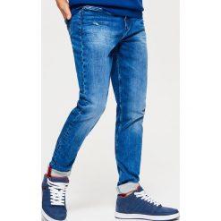 Jeansy SLIM - Granatowy. Niebieskie jeansy męskie slim marki QUECHUA, m, z elastanu. Za 139,99 zł.