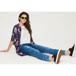 Spodnie damskie: Jeansy skinny z przetarciami - Granatowy