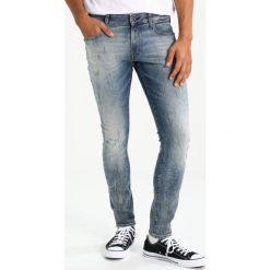 GStar 3301 DECONSTRUCTED SUPER SLIM Jeansy Slim Fit blue denim. Niebieskie jeansy męskie relaxed fit marki G-Star. W wyprzedaży za 363,30 zł.