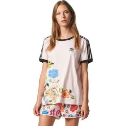 Adidas Koszulka damska Floralita 3 Stripes Tee różowa r. 40 (BR5168). Czerwone topy sportowe damskie Adidas. Za 159,90 zł.