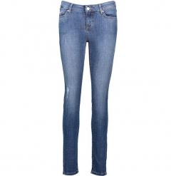 """Dżinsy """"Jasmin"""" - Slim fit - w kolorze niebieskim. Niebieskie spodnie z wysokim stanem marki Mustang, z aplikacjami, z bawełny. W wyprzedaży za 195,95 zł."""