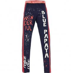 """Legginsy """"Peace & Love"""" w kolorze granatowym. Niebieskie legginsy dziewczęce marki KIPSTA, z elastanu. W wyprzedaży za 32,95 zł."""