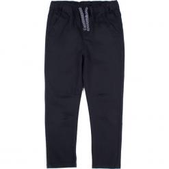 Spodnie. Czarne chinosy chłopięce BASIC BOY, z bawełny. Za 49,90 zł.