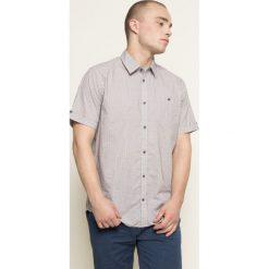 Medicine - Koszula Indigo Resort. Niebieskie koszule męskie na spinki marki MEDICINE, l, z bawełny, z klasycznym kołnierzykiem, z krótkim rękawem. W wyprzedaży za 59,90 zł.