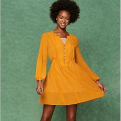 Sukienka z rozkloszowanym dołem - Żółty. Białe sukienki rozkloszowane marki Reserved, l, z dzianiny. Za 139,99 zł.