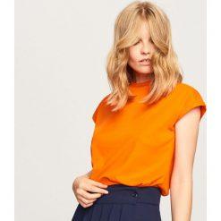Gładki t-shirt - Pomarańczo. Szare t-shirty damskie marki DOMYOS, z bawełny. Za 24,99 zł.