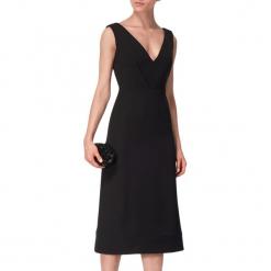 Sukienka w kolorze czarnym. Czarne sukienki na komunię marki BOHOBOCO, z dekoltem na plecach, midi. W wyprzedaży za 1069,95 zł.