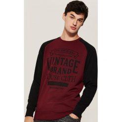 Bluza z raglanowym rękawem - Bordowy. Czarne bluzy męskie rozpinane marki KIPSTA, z poliesteru, do piłki nożnej. Za 79,99 zł.