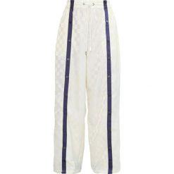 Fenty PUMA by Rihanna TEARAWAY TRACK Spodnie treningowe vanilla ice/evening blue. Białe spodnie dresowe damskie Fenty PUMA by Rihanna, l, z materiału. W wyprzedaży za 575,20 zł.