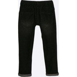 Blukids - Jeansy dziecięce 98-128 cm. Czarne jeansy dziewczęce Blukids, z bawełny. W wyprzedaży za 29,90 zł.