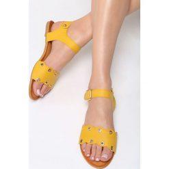 Żółte Sandały Shame On You. Żółte sandały damskie Born2be, z materiału, na obcasie. Za 59,99 zł.