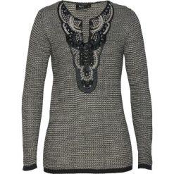 Sweter z aplikacją bonprix czarno-kamienisty. Zielone swetry klasyczne damskie marki bonprix, w kropki, z kopertowym dekoltem, kopertowe. Za 129,99 zł.