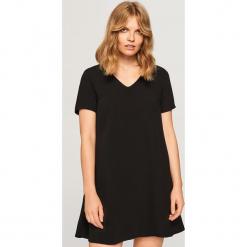 Sukienka mini - Czarny. Sukienki małe czarne marki numoco, l, z długim rękawem, oversize. Za 49,99 zł.