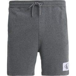 Calvin Klein Jeans HOMEROS SLIM  Spodnie treningowe mid grey heather. Szare jeansy męskie Calvin Klein Jeans. Za 299,00 zł.