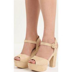 Beżowe Sandały Wildside. Brązowe sandały damskie na słupku marki Born2be, z materiału, na wysokim obcasie. Za 34,99 zł.