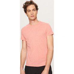Melanżowy T-shirt BASIC - Pomarańczo. Fioletowe t-shirty męskie marki KIPSTA, m, z elastanu, z długim rękawem, na fitness i siłownię. Za 19,99 zł.