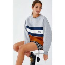 Odzież damska: Szara bluza college z panelem w kolorze ochry