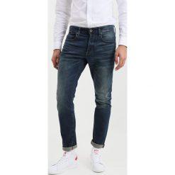 GStar 3301 TAPERED Jeansy Zwężane dava stretch denim. Białe jeansy męskie marki G-Star, z nadrukiem. Za 419,00 zł.