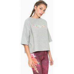 Dwustronna koszulka w kolorze szarym ze wzorem. Szare bluzki sportowe damskie Desigual Sport, s. W wyprzedaży za 130,95 zł.