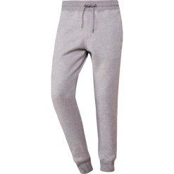 Emporio Armani PANTALONI Spodnie treningowe mottled grey. Szare spodnie dresowe męskie marki Emporio Armani, l, z bawełny, z kapturem. Za 639,00 zł.