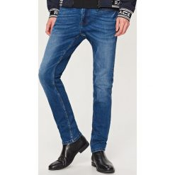 Rurki męskie: Jeansy rurki skinny fit - Granatowy