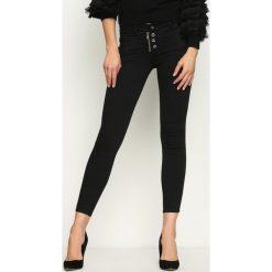 Spodnie damskie: Czarne Jeansy Spinning