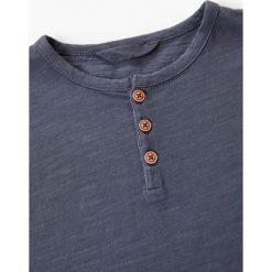 Mango Kids - T-shirt dziecięcy Pani 104-164 cm. Szare t-shirty chłopięce Mango Kids, z bawełny, z okrągłym kołnierzem. Za 29,90 zł.