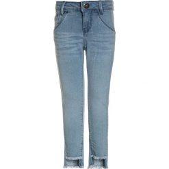 Tumble 'n dry Jeansy Slim Fit denim bleach. Niebieskie spodnie chłopięce Tumble 'n dry, z bawełny. Za 149,00 zł.