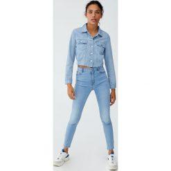 Jeansy super skinny fit z wysokim stanem. Szare jeansy damskie relaxed fit marki Pull&Bear, z jeansu, z podwyższonym stanem. Za 79,90 zł.