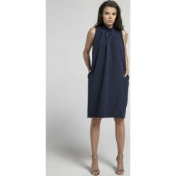 Granatowa Nowoczesna Luźna Sukienka bez Rękawów ze stójką. Niebieskie sukienki na komunię marki ARTENGO, z elastanu, ze stójką. W wyprzedaży za 107,79 zł.