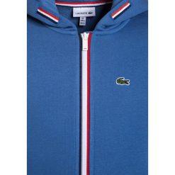 Lacoste Bluza rozpinana blue. Niebieskie bluzy dziewczęce rozpinane marki Lacoste, z bawełny. W wyprzedaży za 263,20 zł.