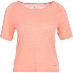 Nike Performance MILER Tshirt basic crimson pulse/heather. Brązowe topy sportowe damskie Nike Performance, l, z elastanu. Za 149,00 zł.
