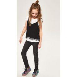 Jeansy slim fit - Czarny. Białe jeansy damskie relaxed fit marki FOUGANZA, z bawełny. Za 129,99 zł.