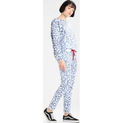 Juvia LEOPARD JOGGER Spodnie treningowe blue. Niebieskie spodnie dresowe damskie Juvia, xs, z bawełny. W wyprzedaży za 405,30 zł.