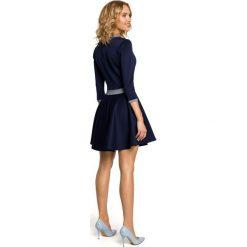 JENNIFER Elegancka rozkloszowana sukienka z koła - granatowa. Niebieskie sukienki balowe marki numoco, na imprezę, s, w kwiaty, z jeansu, sportowe. Za 129,99 zł.