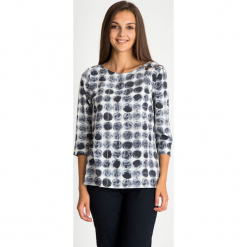 Bluzka z rękawem 3/4 w motyw kół QUIOSQUE. Białe bluzki asymetryczne QUIOSQUE, l, z nadrukiem, z bawełny, z długim rękawem. W wyprzedaży za 99,99 zł.