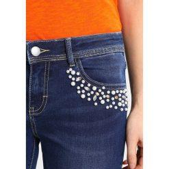 Cartoon Jeans Skinny Fit middle blue denim. Niebieskie rurki damskie Cartoon. W wyprzedaży za 341,10 zł.
