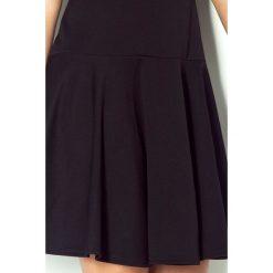 Malaysia Tenisowa sukienka z krótkim rękawkiem - czarna lacosta. Sukienki małe czarne numoco, z krótkim rękawem. Za 129,99 zł.